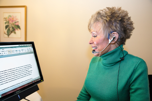 Woman Using Voice Recognition Software