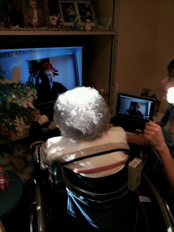 Freda using Skype to talk to her son.