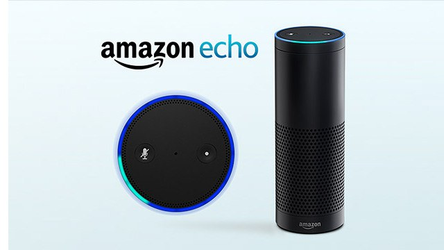 Photo of the Amazon Echo. It is a black cylinder about 1 foot tall and 3 inches in diameter.