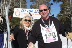 Photo of Beth and Donnie at the Race Day Finishing line at Black Hills Ski for Light.