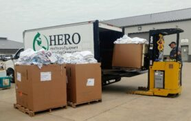 HERO truck being unloaded with donations
