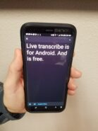 Image of person holding a cell phone with Live Transcribe app