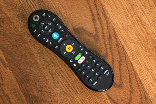 Photo of the new TiVo Remote with the large blue microphone button in the top middle.