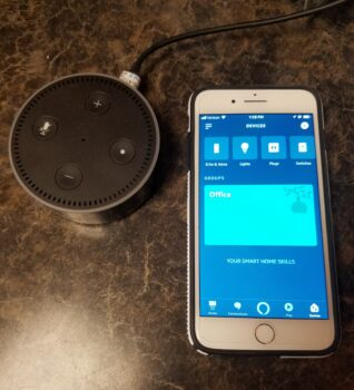Picture of an Echo Dot and Amazon Application on an iPhone