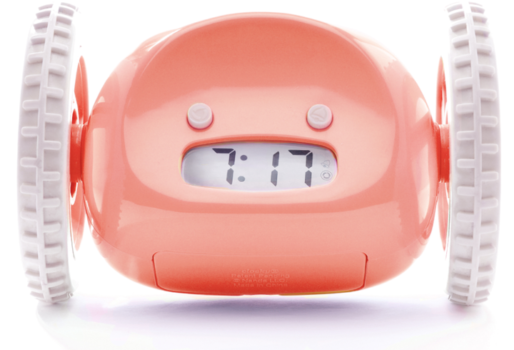 salmon-colored alarm clock with wheels