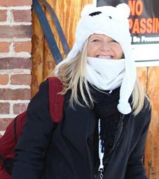 Photo of Beth wearing a polar bear hat and winter gear