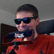 Photo of young many with sunglasses using Jamboxx